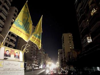Hezbollah flags wave in Beirut on January 12, 2011. (Joseph Eid/AFP/Getty Images)