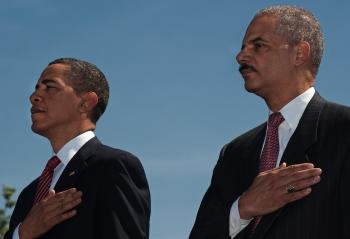 US President Barack Obama and US Attorney General Eric Holder(Rt) honoring fallen police officers from around the US that died in the line of duty, on the West Lawn of the US Capitol, May 13.  (Paul J. Richards/Getty Images )