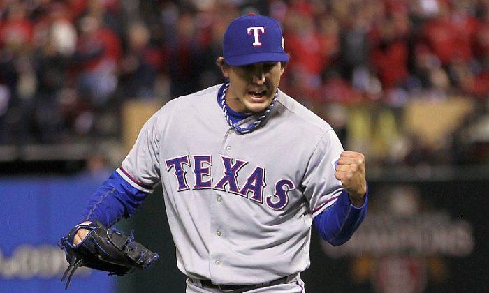 Derek Holland went 2-0 with a 3.38 ERA in last year's playoffs. (Ezra Shaw/Getty Images)
