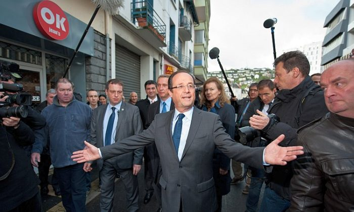 Socialist Party candidate François Hollande leaves the polling office after casting his vote during the first round of the 2012 French presidential election on April 22 in Tulle, France. (Getty Images)