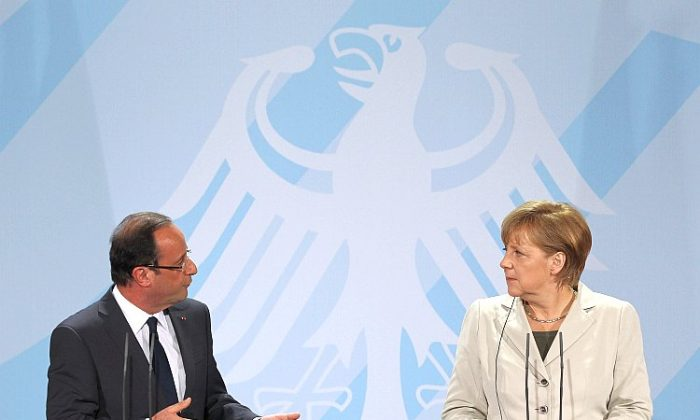 French President François Hollande (L) and German Chancellor Angela Merkel speak to media following talks at the Chancellery about the European debt crisis on May 15, in Berlin, Germany. (Sean Gallup/Getty Images)