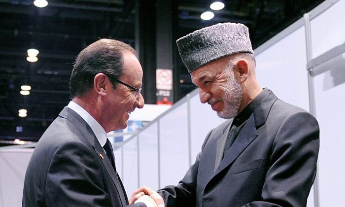 French President François Hollande (L) shakes hands with President of Afghanistan Hamid Karzai (R) at the NATO summit at McCormick Place in Chicago, Ill., on May 20. (Olivier Douliery/AFP/GettyImages