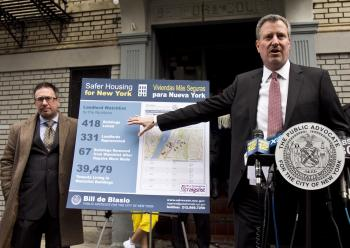 ON THE PROWL: Public Advocate Bill de Blasio outlines his eight-point plan in front of a dilapidated building on 197th Street, between Bainbridge Avenue and Pond Place, owned by Joshua Neustein. (Phoebe Zheng/The Epoch Times)