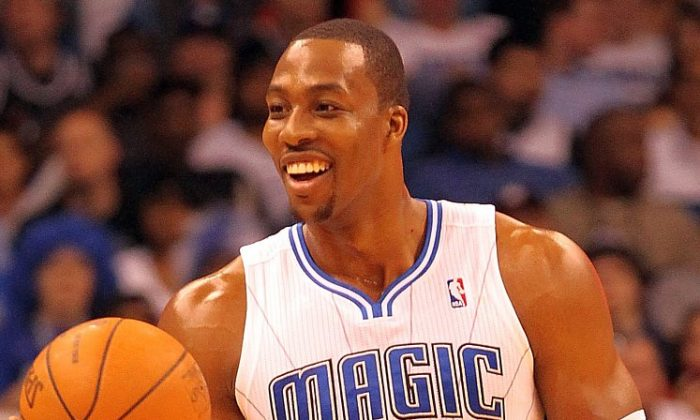 Dwight Howard will not opt out of his contract this summer. (Sam Greenwood/Getty Images)