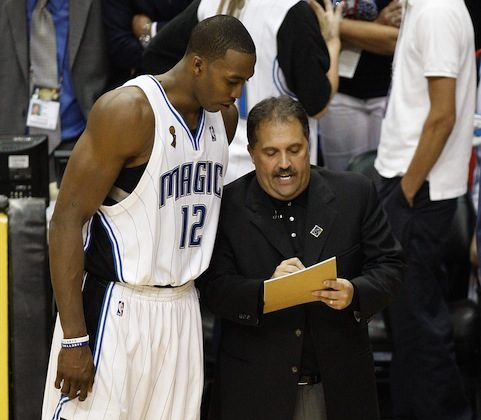 Stan Van Gundy (R) and Dwight Howard (L) led the Magic to the playoffs in all five seasons of their pairing. (Ronald Martinez/Getty Images)
