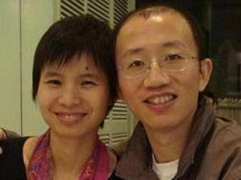 Civil rights Activist Hu Jia and his wife, who is presently under strict house arrest.  (The Epoch Times)