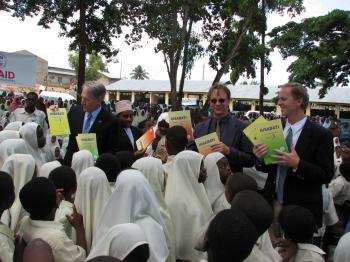 Distributing books to schoolchildren in Tanzania, summer 2006. (L to R) Michael Retzer, then-U.S. Ambassador to Tanzania; Pat Plonski, Executive Director of Books for Africa; David Murphy, President and CEO, Better World Books. (Courtesy of Better World Books)
