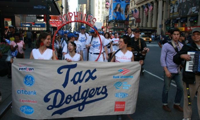 Protesters acting as the fake baseball team 'The Tax Dodgers' march on 7th Avenue on April 17, demonstrating against tax injustice. (Christian Watjen/The Epoch Times)