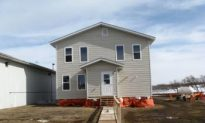 Prison Inmates Build Home for Needy Family