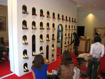 HIGH FASHION: Shoppers peruse high heel shoes at Christian Louboutin in Paris, France on June 16. (Ben Zgodny/The Epoch Times)
