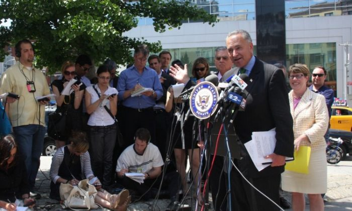 U.S. Sen. Charles Schumer speaks about inter-city bus safety from a Chinatown sidewalk Thursday. (Hannah Cai/The Epoch Times)