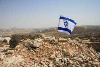 An Israeli flag on a disputed hilltop next to Efrat. The settlement's municipality wants to build new homes on the disputed land. (Genevieve Long/The Epoch Times)