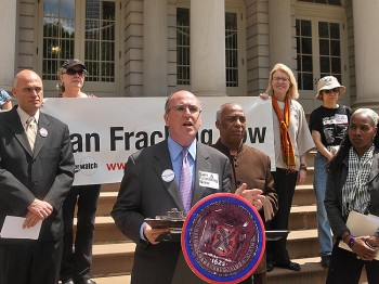 Eric Weltman, senior organizer of Food & Water Watch, is joined by fracking ban supporters like David Braun (L), founder of United for Action, and Councilman Charles Barron (R), while outlining the findings of a newly released report 'The Case for a Ban on Gas Fracking,' on Monday at City Hall. (Gary Du/The Epoch Times )