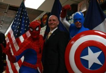 FIREFIGHTING POWER! Spiderman (L), and Captain America (R) join Fire Commissioner Salvatore J. Cassano (C) in fighting a fiery foe.  (Tara MacIsaac/The Epoch Times)
