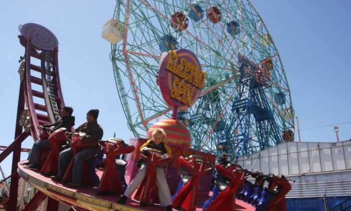 A file photo of riders enjoying the Electro Spin at Coney Island's Luna Park. (Tara MacIsaac/The Epoch Times)