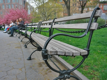 HOT SEAT: Pictured here on Monday, the benches in Washington Square Park are made of ipe, a tropical hardwood from the Amazon rainforest. New benches, also made from ipe, are set to be installed. (Tara MacIsaac/The Epoch Times)