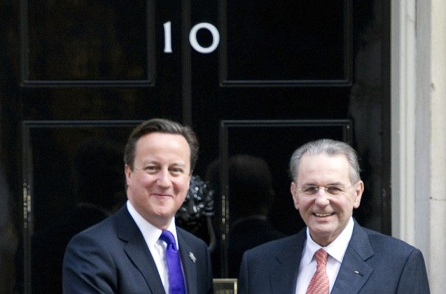 British Prime Minister David Cameron (L) shakes hands with International Olympic Committee (IOC) President Jacques Rogge (R) during a meeting in central London March 28. (Miguel Medina/AFP/Getty Images)