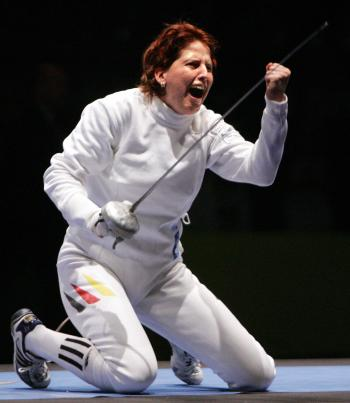 October 14, 2005 in Leipzig. Duplitzer after her victory, helping her team win the bronze medal against Russia during the World Fencing Championship (Jacques Demarthon/AFP/Getty Images)