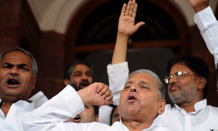 Samajwadi Party (SP) Chief Mulayam Singh (R) and Members of Parliament shout slogans outside parliament in New Delhi on July 29, 2010. The SP recently won a clear majority in elections in the state of Uttar Pradesh according to the Times of India. (PrakashSingh/AFP/Getty Images)