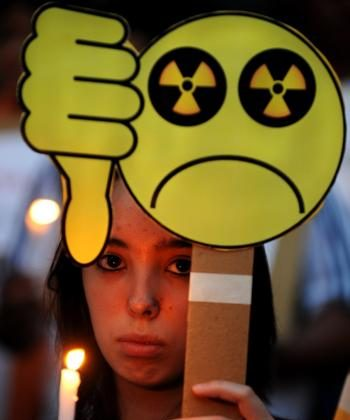 An Indian woman protests nuclear power and show respect for those who died in the Japan earthquake. (Dibyangshu Sarkar/AFP/Getty Images)