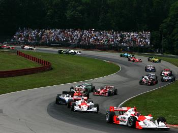 Ryan Briscoe and teammate Helio Castroneves lead the field at the start of the IRL IndyCar Series Honda Indy 200.  (Darrell Ingham/Getty Images)