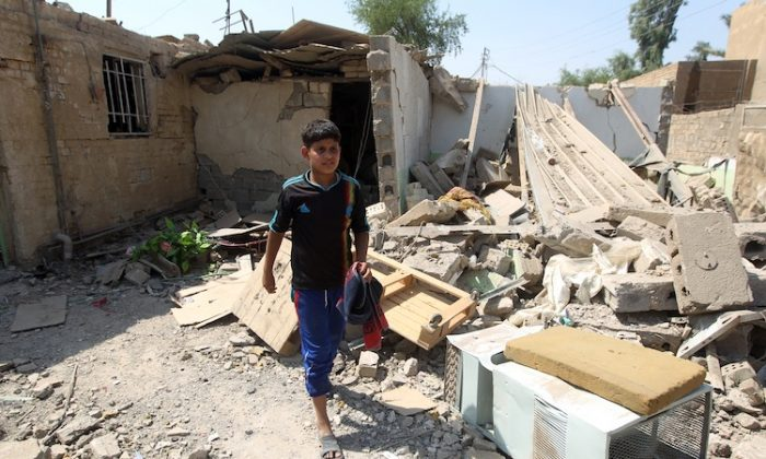 Elven-year-old Mohammad searches for salvageable items amid the rubble of his family's destroyed house following a series of bomb attacks in the town of Taji, north of Baghdad on July 23. (Ahmad Al-RubayeAFP/GettyImages)