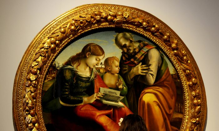 "Paintings by Italian Renaissance master Luca Signorelli (circa 1450–1523), whose works influenced Michelangelo, are on view at the Palazzo dei Notari in Perugia, Italy, through Aug. 26. ""The Holy Family,"" by Luca Signorelli, circa 1490, oil on wood. (TIZIANA FABI/AFP/Getty Images)"