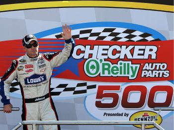 Jimmie Johnson won the NASCAR Sprint Cup Series Checker O'Reilly Auto Parts 500 at Phoenix International Raceway on November 15, 2009, almost ensuring his fourth consecutive championship. (Christian Petersen/Getty Images)