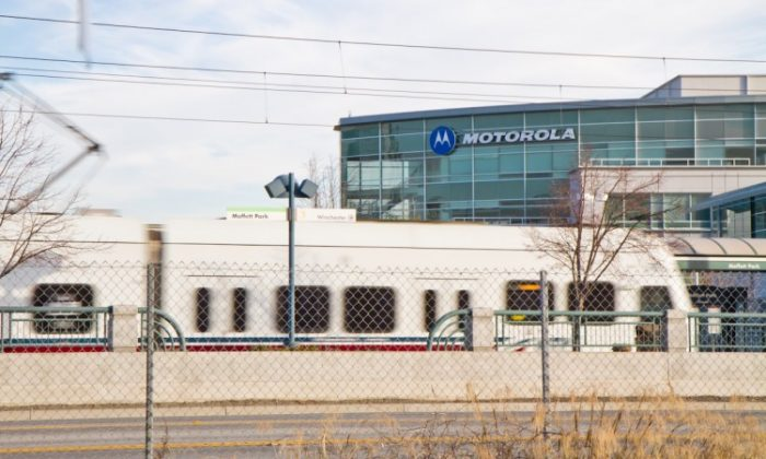 A light rail transit train arrives near Motorola Mobility's Silicon Valley office, part of the Moffett Towers campus, on Feb. 3. Motorola recently scored a huge second round legal win against Apple in Germany on a patent case involving Apple's iCloud service. (Jan Jekielek/The Epoch Times)