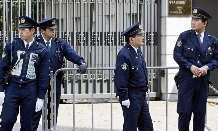 Policemen stand guard in front of the Chinese Embassy in Tokyo, 17 April 2005. The first secretary of the embassy recently fled to China after allegedly spying on businessmen and politicians. (Toru Yamanaka/AFP/Getty Images)