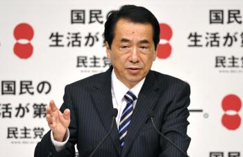 Japan's Prime Minister Naoto Kan during a press conference, after his victory in the centre-left Democratic Party of Japan (DPJ) presidential elections in Tokyo on Sept. 14, 2010.  (Kazuhiro Nogi/AFP/Getty Images)