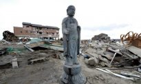 Buddha Statues Stand Amid Rubble After Tsunamis