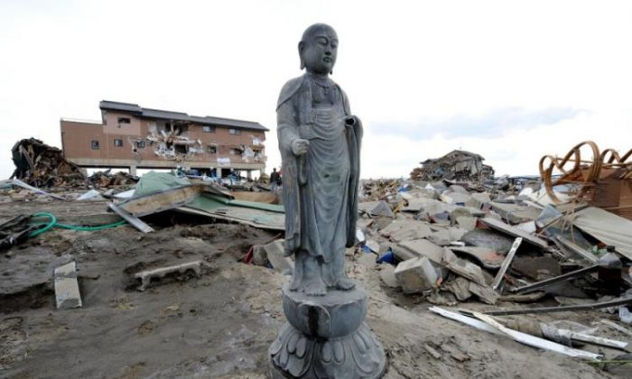 ABOVE AND BEYOND: A Buddha statue sits amid the rubble with skeletons, which were washed up from a nearby graveyard by the deadly tsunamis of December 26 in the southwestern coastal town of Kahawa in Sri Lanka, Jan. 2, 2005. (Raveendran/AFP/Getty Images)