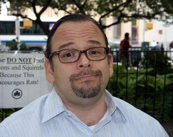 Jason Jarushewsky, 44, attorney, `Don't think Starbucks is on their way out. I gave up caffeine three years ago.  I like that they post all of the calories next to their treats now, but I don't think it'll really affect me. It's Newark!` (Katy Mantyk The Epoch Times)