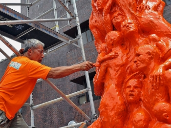 Danish artist Jens Galschiot painted his artwork Pillar of Shame orange, a color symbolizing discontent with the Chinese regime.  (Ted Aljibe/Getty Images)