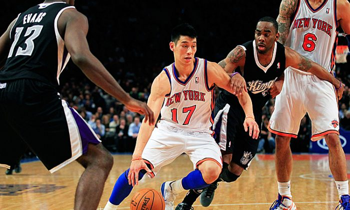 Jeremy Lin (17) hasn't even been a star for two weeks, but he's made a huge impact already. (Chris Trotman/Getty Images)