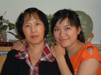 DAUGHTER AND MOTHER: Jin Pang and her mother, Cao Junping, pose for the last photo together in 2007 in China before Ms. Pang left for the U.S. (Jin Pang)