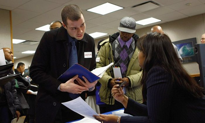 Former U.S. Marine Sean Ghigliotty, unemployed for nine months, meets a potential employer during a veterans job fair Feb. 1 in New York City. According to a report released Feb. 3 by the Bureau of Labor Statistics, 257,000 jobs were added to the private sector in January. (John Moore/Getty Images)