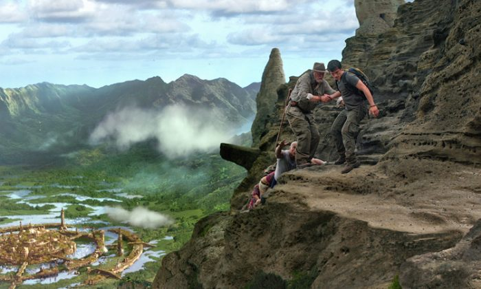 "Dwayne Johnson (L), Michael Caine (C), and Josh Hutcherson (R) climb above ""The Lost City of Atlantis"" on a mysterious island in the action-adventure ""Journey 2."" (Warner Bros. Ent.)"