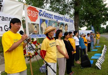STOP THE PERSECUTION: Lu Yang speaking at a rally across the street from the Chinese embassy in Ottawa marking nine years of the persecution of Falun Gong by the Chinese communist regime. (Samira Bouaou/The Epoch Times)