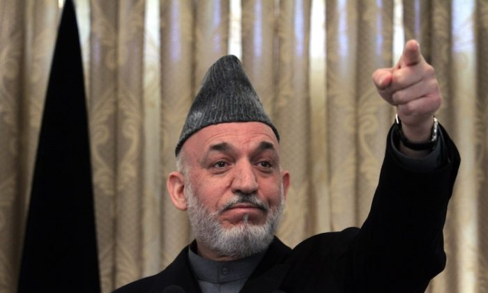 On Monday, Afghan President Hamid Karzai, seen here at a press conference in Kabul on Feb. 8, 2011, ascribed blame for a wave of militant attacks the day before on poor NATO intelligence. (Majid Saeedi/Getty Images)