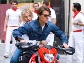 ACTION: Roy (Tom Cruise) and June (Cameron Diaz) race through the streets of Seville, Spain in the action comedy 'Knight and Day.' (Frank Masi/Twentieth Century Fox)
