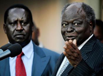 Kenyan President, Mwai Kibaki [R] alongside prime minister, Raila Odinga addresses the press on July 30, 2009, at the State House in Nairobi. (Tony Karumba/AFP/Getty Images)