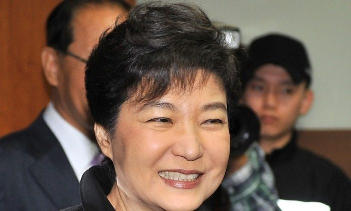 Park Geun-Hye, interim leader and likely presidential candidate of the ruling conservative Saenuri Party, smiles after her speech in Seoul on April 12, as her party won a majority in National Assembly elections. (Jung Yeon-Je/AFP/Getty Images)