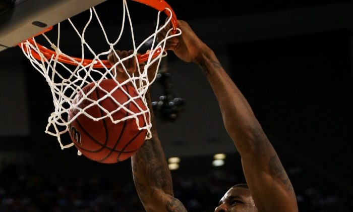 Robinson tallied 18 points and 17 rebounds in the championship game loss to Kentucky. RONALD MARTINEZ/GETTY IMAGES