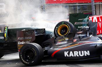Smoke comes off the crashed cars Jarno Trulli (L) and Karun Chandhok during the final laps of the Formula One Monaco Grand Prix. (Guillaume Baptiste/AFP/Getty Images)