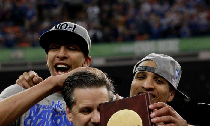 Kentucky head coach John Calipari (C) won his first National Championship Monday night at the Final Four. (Ronald Martinez/Getty Images)