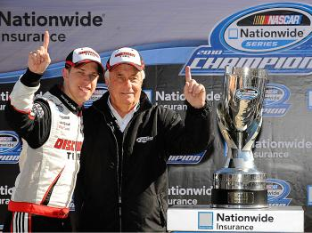 Brad Keselowski celebrates with TEAM OWNER Roger Penske after winning the Nationwide Championship with a third-place finish in the NASCAR Nationwide Series O'Reilly Auto Parts Challenge at Texas Motor Speedway. (Rusty Jarrett/Getty Images for NASCAR)