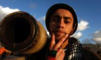 Libya Protesters Change Tack, Take Up Arms
