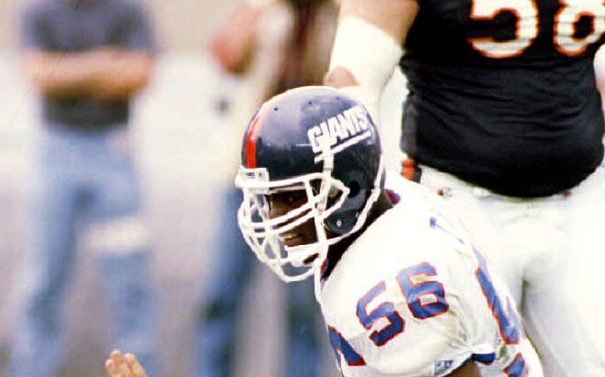 Lawrence Taylor (56) was the second overall pick in the 1981 draft and retired as the NFL's all-time leader in sacks. (Eugene Garcia/AFP/Getty Images)
